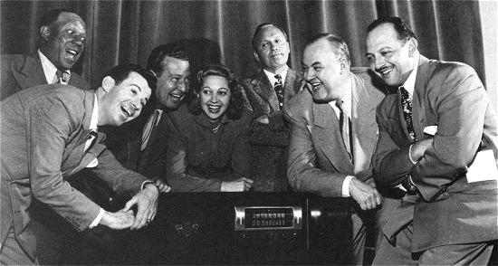 Show regulars: Eddie Anderson, Dennis Day, Phil Harris, Mary Livingstone, Jack Benny, Don Wilson, and Mel Blanc.