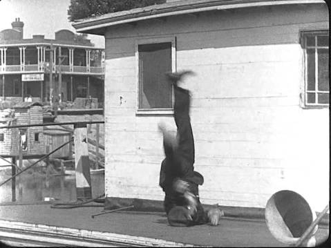 A still from Steamboat Bill, Jr. shows Buster Keaton in the midst of a pratfall
